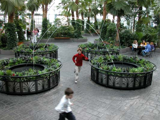Crystal Gardens at Navy Pier in Chicago, IL display iron work surounding garden fountains